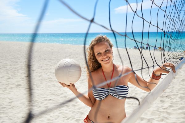 Portrait Of Woman With Volleyball Playing Beach Volley